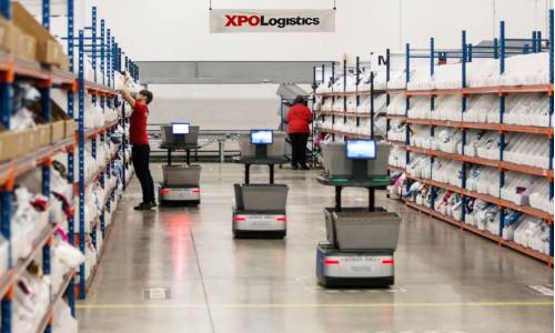 Robots work alongside people at an XPO Logistics facility